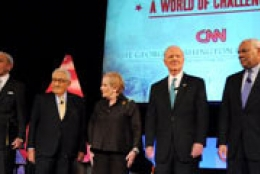 line of prominent speakers on stage at a GW-CNN joint event