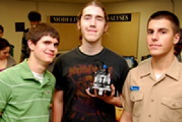 Three male students smiling