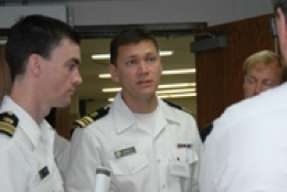 group of men in military attire talking