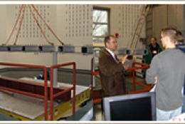 students in front of earthquake simulator equipment