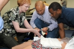 group of students completing EMT practice exercise